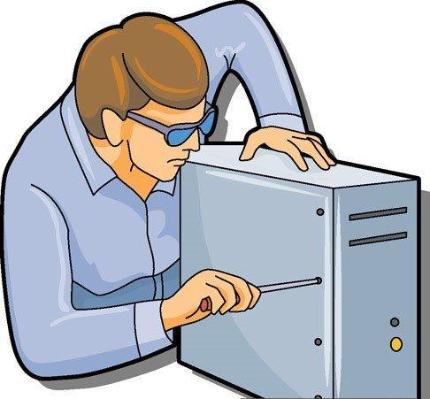 На картинке изображен специалист it, который ремонтирует компьютер